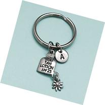 Sun tan lotion keychain, sun tan lotion charm, lotion