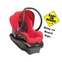 Maxi-Cosi Mico Nxt Infant Car Seat with a Baby on Board Sign
